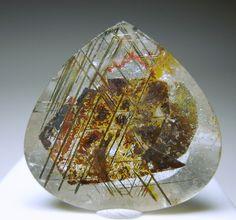 Quartz with rutile needles and hematite Brazil