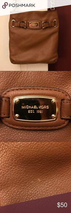 Michael Kors Small Crossbody Bag Good condition, pictures are posted of a few little flaws. Soft leather. Great bag with a lot of life left! Michael Kors Bags Crossbody Bags