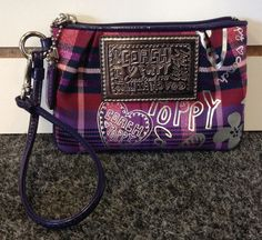 Authentic Coach Limited Edition Purple Poppy Tartan Glam Plaid Wristlet priced at SOLD!! Was available at Gadgets and Gold in Gainesville, FL!