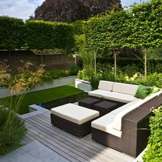 Bright garden with rattan sofa | adamchristopherdesign.co.uk