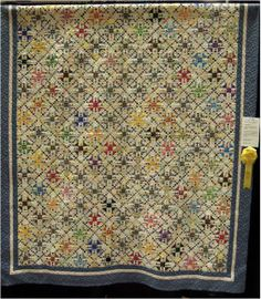 """""""OMG- A Million Tiny Pieces"""" by Joan McNamara, 2013 AZQG. Design by Sue Garman.  Churn Dash and Nine Patch blocks; there are over 15,000 pieces in this quilt."""