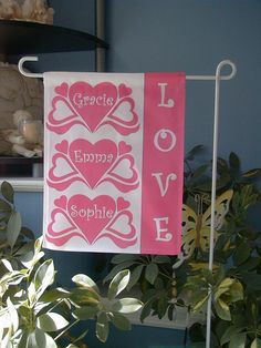 Two-sided Personalized Garden Flag - $45    You name it - I can make it.    This is a sample of a flag I made for a grandmother to give to her triplet granddaughters for Valentine's Day. I made flags for all the holidays for her to gift to them.