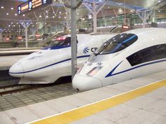 Bullet trains at Tianjin Train station, Tianjin China. Travels up to 350km/hr (217 mph) between Tianjin-Beijing (dist. 140km/87 mi) and takes between 15-30 mins travel time.