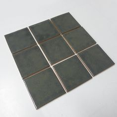 Metallic Smoke 'n' Mirrors glaze.  Handmade Ceramic Tile from Mercury Mosaics.  These are 3x3s in the Overstock Store.