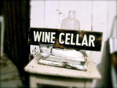 http://www.etsy.com/shop/SimonSaysSigns?ref=seller_info The WINE CELLAR hand-painted sign on 100 year-old red pine by SimonSaysSigns, $34.00