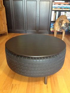 Repurposing an used truck tire into furniture The best part is the top lifts off and there is a ton of storage inside the tire. Tire Table, Tire Chairs, Tire Furniture, Recycled Furniture, Furniture Ideas, Tyres Recycle, Diy Recycle, Recycling, Used Tires