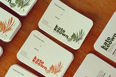 Examples of Kate Keown's Massage Therapy Business Cards, designed in three different color schemes.