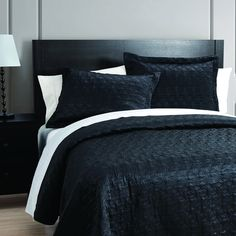 Love your luxuriously soft matte satin coverlet with its elegant vintage pattern and rich black color. This matte satin coverlet is perfect as an elegant layering piece.