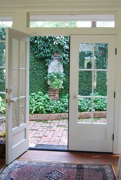I love French doors and plant covered walls/fences. French doors opening onto a courtyard Victorian Patio Doors, French Doors Patio, French Windows, Garden Great Ideas, Garden Doors, Fence Garden, Back Patio, Small Patio, Backyard Patio