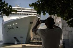 U.S. Issues Regulations Making It Harder for Americans to Visit Cuba  In this June 17 2017 file photo a man takes a photo of a cruise ship in Havana harbor Cuba. President Donald Trump announced a new policy in June that partially rolled back the recent diplomatic opening with Cuba. New regulations implementing that policy are being unveiled Wednesday. Ramon Espinosa / Associated Press  Skift Take: We knew this was coming and now there is more meat on the bone in the details to consider…