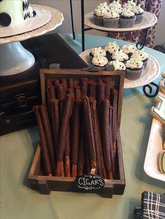 Little man birthday. Dessert table. Chocolate covered pretzels. Cigars