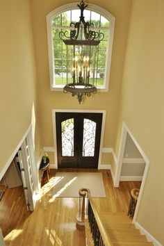 Traditional Entryway with High ceiling, Iron Double Door, Hardwood floors, Carpet, Chandelier