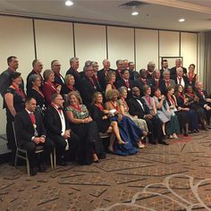 #CCAC 50 Distinguished Alumni line up to get a group photo in their medallions at the #CCAC50gala