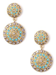 These spectacular earrings marry the mesmerizing colors of the ocean with fierce, almost shield-like disks for a cool warrior vibe. That the gemstones are set in a bold radiating pattern only adds to the intrigue.