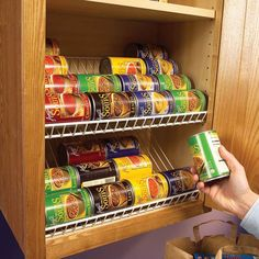 Kitchen Storage Ideas: Turn wire shelving backwards and on a tilt to create functional can storage.