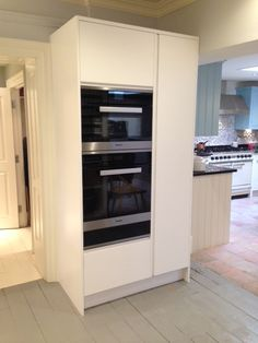 This tall cabinet, in our Pure cabinetry style, houses an array of oven appliances, including a very handy warming drawer. To the right is a tall larder with a mix of shelves and pull-out chrome baskets inside. Shown here in Pure White. http://www.john-lewis.co.uk/kitchens/contemporary-pure-kitchen
