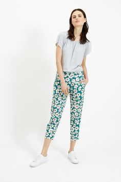 Green woven trouser with floral print in 100% organic certified cotton. Side pockets with elasticated rear waistband. Length 88cm.