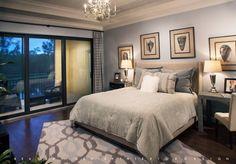 A master bedroom retreat designed by Beasley & Henley Interior Design. Home designs in Naples, FL.