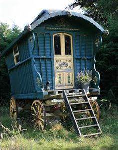 I wanted my grandfather to build me a gypsy caravan and set it up on the edge of the woods, near the stream,  looking out over the pasture.  I pictured something like this.  I can still picture just how I wanted the interior decorated.  Wouldn't it've made a beautiful play house for a little girl?