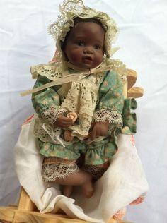 Yolanda Bello African American/Hispanic Porcelain Doll in a Wooden Crib