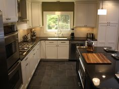 So many things i love: window above sink, island, double oven, large tile! Would have diff colors tho . . .