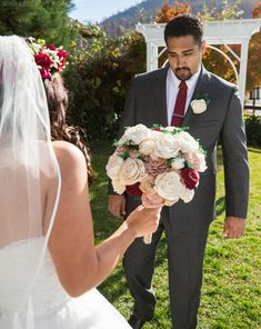 Groom's First Look Reaction: See more wedding photos from this red fall wedding at Bass Lake (The Pines Resort). | Slashed Beauty