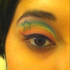 To do this i used a pallet of eyeshadows i got from ross for $3.99. I put a thin layer of vaseline on my lids to help the eyeshadow stick and allow the color to become more vivid. I then made a rainbow using small soft dabs on the lid as having vaseline doesn't exactly let you sweep it on. It stayed on until the night was over! :)