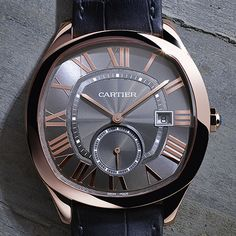 Drive de Cartier in pink gold with a grey guilloché dial marked by Roman numerals punctuated with sword-shaped hands.
