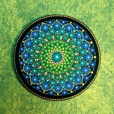 My mandala wood panels are hand painted on round wooden discs with a nice beveled edge, and are protected with two coats of matte vanish. They are not suitable for outdoor use however, and NOT to be used as a coaster. The smooth surface of these wood panels is a wonderful surface to