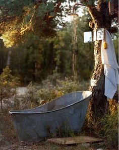 A tin bath, outside, with a high back so you can sit up in it.