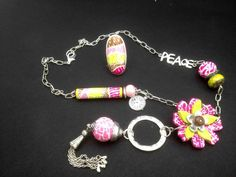 """Love the polymer """"cut flowers"""" in a lariat design."""