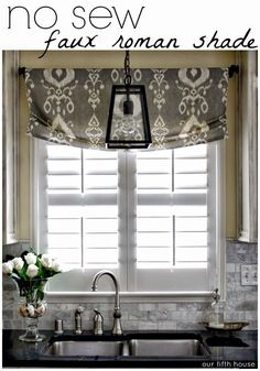 Pendant light over sink and roman shade for window