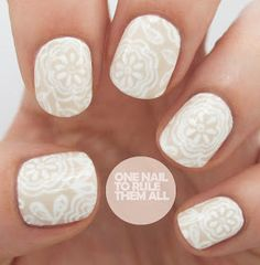 Nude and white floral nail art