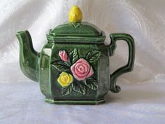 Green Majolica teapot with yellow and pink roses.