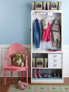 Apartment Decorating Ideas: If your apartment lacks an actual entryway, create your own with a bookcase. Take out the top shelves and install hooks for coats. Add extra hooks on the sides. Place baskets or bins in the bottom for storage. Dress it up by adding wallpaper to the back or painting it.