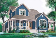 Farmhouse with full wrap around porch and detached garage with breezeway -- uh yes please on a lake!