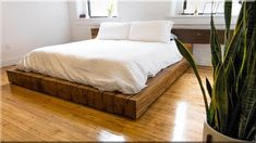 Workshop designs and builds a bed frame using reclaimed oak beams.