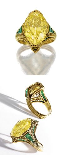 RARE AND IMPORTANT FANCY INTENSE YELLOW DIAMOND & EMERALD RING, TIFFANY & CO., DESIGNED BY LOUIS COMFORT TIFFANY, CIRCA 1915-1920.  The oval diamond of fancy intense yellow color weighing 11.05 carats, within a gold filigree mounting set with calibré-cut emeralds, foliate pattern engraved inside shank, signed Tiffany & Co.  Accompanied by the original silk floral box in the Japonesque style.   These boxes were used only for the art jewelry designed by Louis Comfort Tiffany.