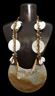 "Kina Shell Necklace. Sepik Tribe.  Kinas are rare treasures from Papua New Guinea and a sign of wealth and prosperity. They can be used for bride price, blood feud paybacks and exchange festivals as well as for admissions to men's clubs and secret societies. They were worn by men and women either alone or in multiples for special celebrations when warriors would wear a kina shell pectoral as the focal point of their dress. Dimensions: 17"" in length, Shell: 6"" across x .16"" in width."
