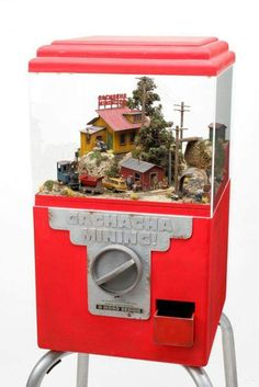 Miniature garden in an old Gumball machine