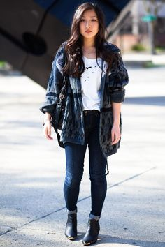 baggy jacket and rolled up skinny jeans, white shirt draws the eye towards area and away from darker shades of color