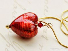 A gorgeous red Murano Heart pendant perfect to bright up any nautical navy and white outfit