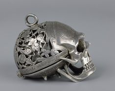 "As the art of horology became more sophisticated watchmakers were able to  create literal ticking reminders of the relentless march of time and soon  ""Death's Head watches"" were being developed, watches and clocks in the  shape of a human skull."