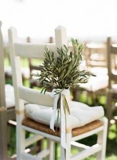 greenery chair decor tied with ribbon - photo by Lindsay Madden Photography