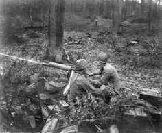West of the German city of Duren, two soldiers of the U.S. 39th Infantry Regiment fire a .30-caliber machine gun toward German positions in the town of Schlich.