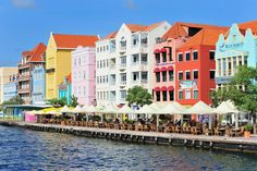 Willemstad Curacao is one of the most exciting cities in the Caribbean.Explore the unique floating bridge, its colorful Dutch inspired buildings and worldclass cuisine. Willemstad, Best Cruise, Cruise Port, Cruise Tips, Cruise Travel, Great Places To Travel, Cool Places To Visit, Southern Caribbean Cruise, Sailing Trips