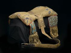 Cree - Metis (Native American). Beaded Saddle, pre 1850. Hide, beads, pigment stroud wool cloth, deer or buffalo hair, old hide parfleche, metal, canvas, 19 1/8 x 13 3/8in. (48.5 x 34cm). Brooklyn Museum, Henry L. Batterman Fund, 46.78.7. Creative Commons-BY (Photo: Brooklyn Museum, 46.78.7_PS2.jpg)