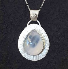 Lovely blue chalcedony stone with a peek-a-boo heart cut in the sterling backplate.   #necklace #handmade #handcrafted #pendant #sterling #heart #giftsforher