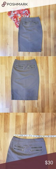 NWT DE COLLECTION SKIRT NWT Miss glam skirt charcoal gray. This is one of my favorite skirts, its so cute with 4 zipper pockets in front and a little slit in back. Very slimming!! DE COLLECTION Skirts Pencil