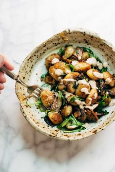 Mushroom Gnocchi with Walnut Pesto and Arugula - a vegetarian bowl that's made with familiar ingredients. Comes together in 30 minutes or less!